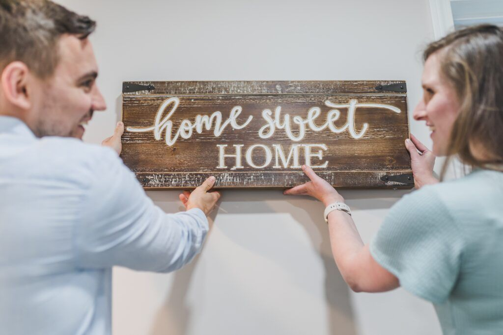 couple decorating for an open house